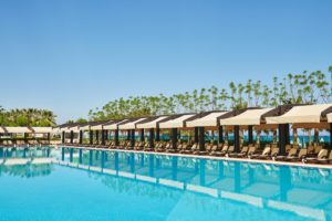 Swimming pool and beach of luxury hotel. Type entertainment complex. Amara Dolce Vita Luxury Hotel