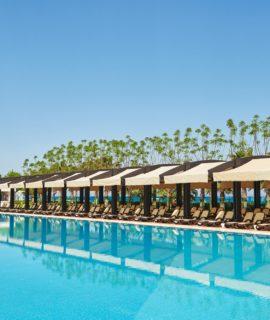 Swimming pool and beach of luxury hotel. Type entertainment complex. Amara Dolce Vita Luxury Hotel